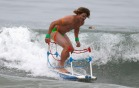 A man dressed as a wrestler in a ring competes in the ZJ Boarding House Halloween Surf Contest in Santa Monica, California