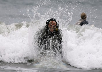 Elena Karavaeva of Russia competes dressed as a zombie in the ZJ Boarding House Halloween Surf Contest in Santa Monica
